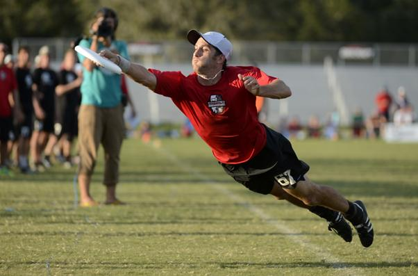 SARASOTA, FL: Ben Cohen (Surly #67) makes a catch, ruled out of bounds, against Boneyard (Cary, NC) in the finals of the masters division at the 2012 USA Ultimate Club Championships. Saturday, October 27, 2012. © Brandon Wu / for UltiPhotos.com.